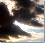[sun peeking through the clouds]