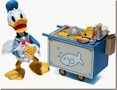 Donald Duck selling curry fish ball