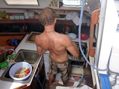 Our captain cooking up a storm in the rocking, swaying kitchen on the boat.