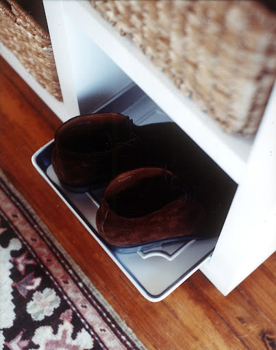 To prevent shoes from leaving dirt and scratches on the cubbie floors, use trays or baking sheets.  Attach some felt surface protectors to the tray bottom so it will slide out easily.
