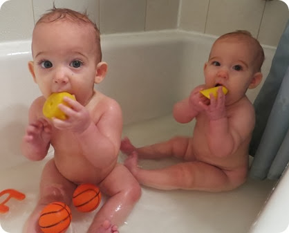 Twins Sitting Up in Bath