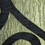 """Połyskująca tkanina obiciowa. """"Esy-floresy"""".Czarna, złota."""