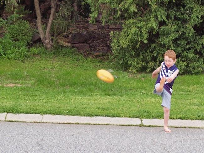 ebe - kicking the footy