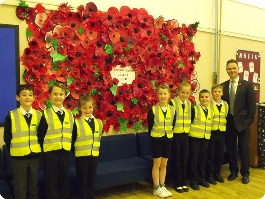 Children and headmaster David Jobling at St Michaels school in their high vis vests
