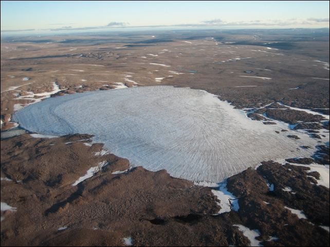 As ice caps like this one, nicknamed Sputnik, melt, they expose tiny plants that have been frozen there for millennia, giving clues to the past climate. New research shows that average summer temperatures in the Canadian Arctic over the last century are the highest in the last 44,000 years, and perhaps the highest in 120,000 years. Photo: Gifford Miller