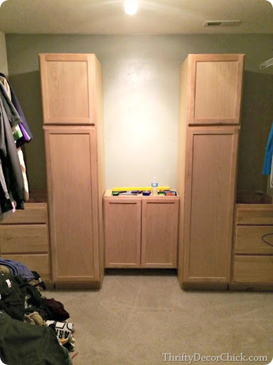 I Ended Up With The Two Drawers On Each Side, The Taller Pantries And Then  In The Middle I Put A 30 Inch Upper Cabinet. This One Holds Shoes. :)