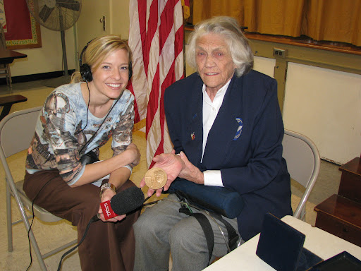 Young displays her Congressional Medal of Honor during an interview with KSMU's Jennifer Moore.