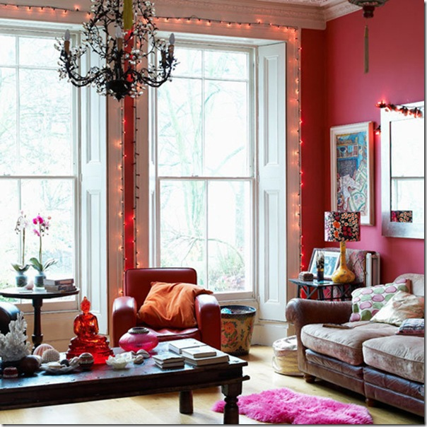 Pink living room floor to ceiling sash window windows ethnic antique coffee Chinese lanterns fairy lights sofa wood flooring rugs armchairs  table real home L etc 03/2009 not used