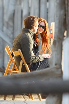Arthur Darvill and Karen Gillan chat on set, as Karen sees the photographer...!