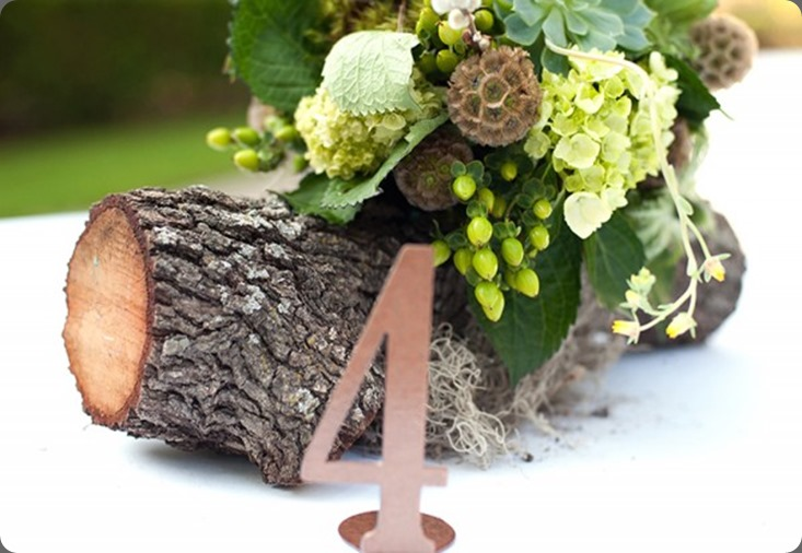 log Rustic-Wedding-Centerpiece-600x399 bows and arrows