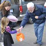 Scotty Mathers hands out candy to the kids during Trunk or Treat