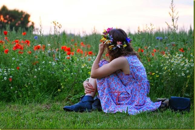girl in wild flower field