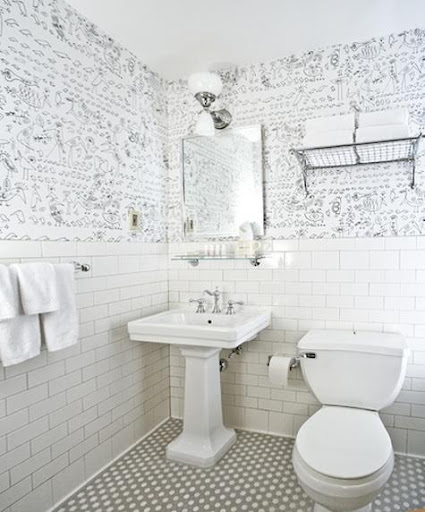Wallpaper adds a bit of interest in this bathroom (designed by William Sofield for the Soho Grand Hotel).