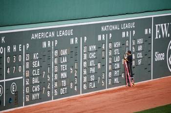 American League vs. National League baseball scoreboard. Mike Pick / flickr.com