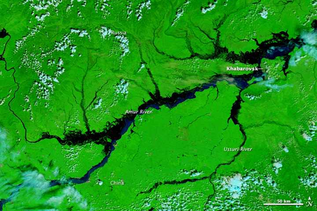 Satellite view of the Amur River near Khabarovsk in eastern Russia, 21 August 2013. In the city of Khabarovsk, the Amur River swelled to a record height of 696 centimeters (274 inches), the worst flood in Russia's history according to Alexander Frolov, chief forecaster of the national weather center. Photo: LANCE/EOSDIS MODIS Rapid Response Team / NASA GSFC