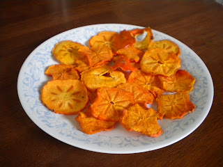 Take out the persimmons when they feel completely dry. There shouldn't be any water pockets in them.