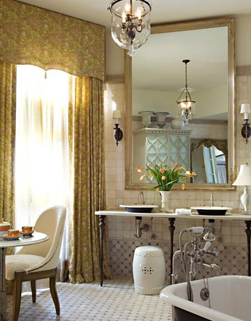A tea table and floor to ceiling drapes in a bathroom -- wow!