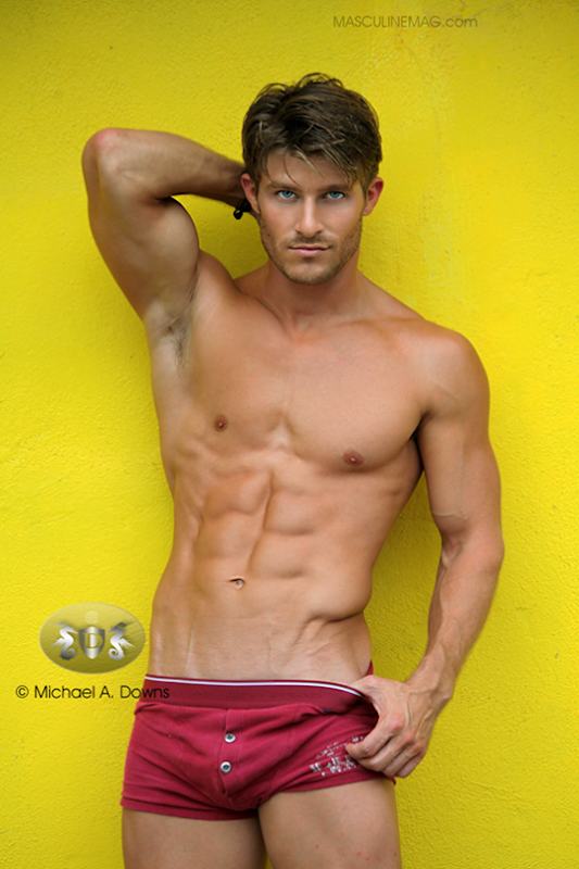 Justin Maina in Maroon Trunks