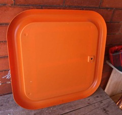 Orange framed mirror, back