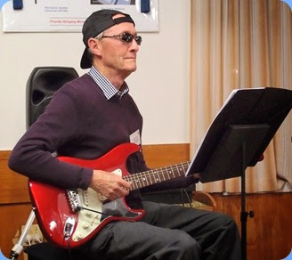 "Brian 'Stevie Wonder' Gunson played us a virtuoso on his guitar and using an mp3 backing for his version of ""Begin the Beguine"". Photo courtesy of the Club's photographer, Dennis Lyons."