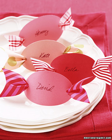 What could be sweeter? Cut out 3-inch ovals from colorful card stock. Using a hole punch, make a hole at each end, and then neatly write your guests' names on the ovals with black ink. Thread ribbon scraps, each about 6 inches long and 1 1/2 inches wide, through the backs of the place cards. Notch the ribbon ends, and set a card at each place setting.