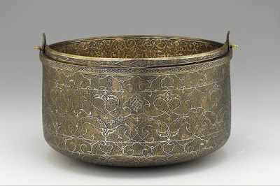 Bucket | Origin:  Venice,  Italy | Period: mid-16th century | Details:  Not Available | Type: Bronze inlaid with sliver | Size: H: 32.2  W: 30.2  cm | Museum Code: F1945.14 | Photograph and description taken from Freer and the Sackler (Smithsonian) Museums.
