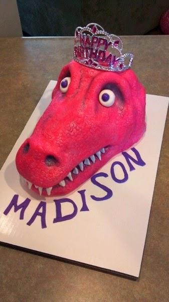 Pink princess t rex cake
