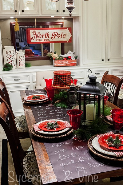 Vintage plaid tinware and North Pole inspired accents in the dining room. A truly stunning Christmas Home Tour as part of the Christmas in the Country Blog Tour. This Plaid Inspired Country Christmas will knock your socks off. Features tours of the Living room, Dining Room and a Cocoa hot chocolate bar in the Breakfast room. There is so much inspiration for Christmas decorations in this one post. Be prepared to feel like you are cuddled up by the fire in a warm Northwoods comfy cottage! #country #Christmas #Plaid #Holiday decorating #Holiday ideas #Holidays #Christmas decor #Holiday decor