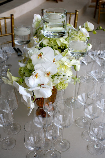 Here, the table decor in progress. The orchids are so lush and beautiful.