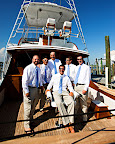 Brad and his groomsmen wore Jos. A. Bank suits and flip flops for his seaside wedding in Florida. They relaxed on a boat in the Destin harbor before the wedding.