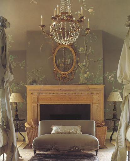 The high ceilings, French chandelier, satin settee and old stripped mantel make this master bedroom a theatrical space.