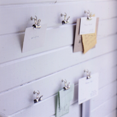 Screw hooks and clips are an easy way to keep important papers visible.