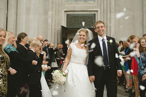 After the ceremony, the newlyweds were showered with heart-shaped confetti, and grinning smiles of the surrounding tourists.