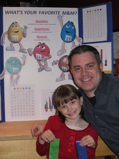 Natalie & Dad posing in front of project board.