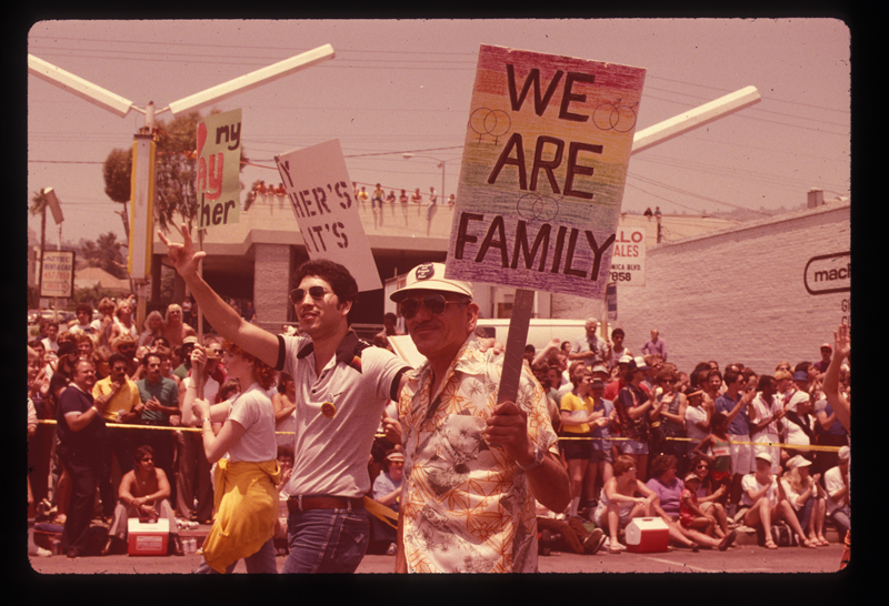 Families marching in the Los Angeles Christopher Street West pride parade. 1982.