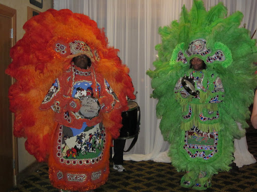 Two Mardi Gras Indians danced at the entrance to the party.