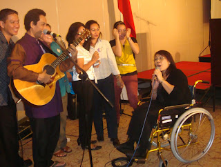 NCDA Executive Director Geraldine Ruiz sings together with Mr. Joey Ayala.