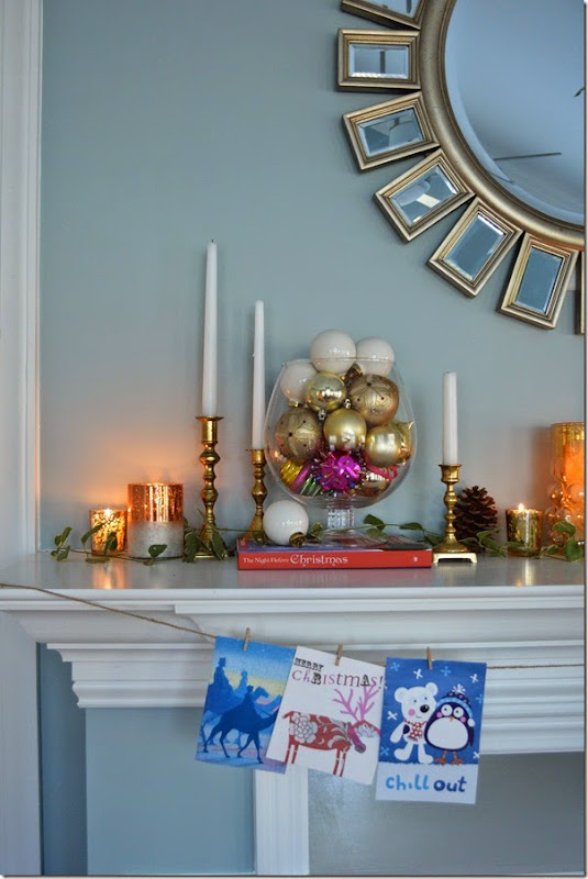 Use Christmas Cards, candles, and place ornaments in apothecary jars for a warm and inviting Holiday mantel.