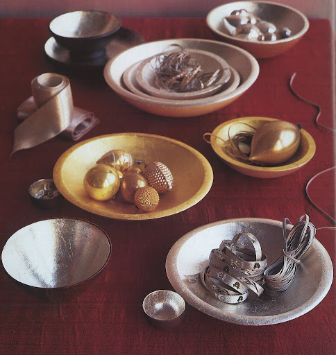 Wood and ceramic bowls are finished with 18-karat yellow-gold leaf and 24-karat white-gold leaf, which actually create a softer effect than silver leaf.