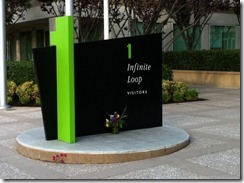 Flowers sit near a sign at Apple headquarters in Cupertino, Calif.