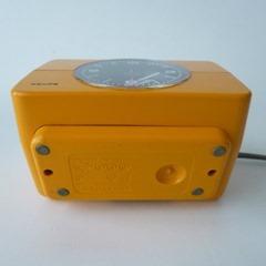 yellow Krups alarm clock bottom