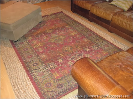 layered rug with old rug on sisal