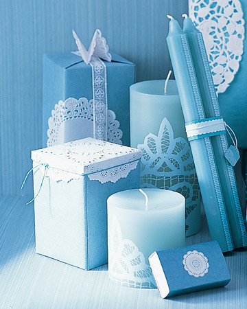 Embellish a plain taper candle with a lacy doily for an elegant effect.