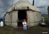 Kyrgyz girl posing in front of the yurt
