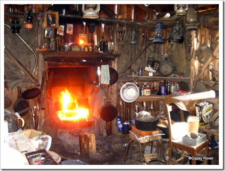 Inside the bearded miners shack with earth floor. Basic and simple. There is always a billy boiling on the hob.