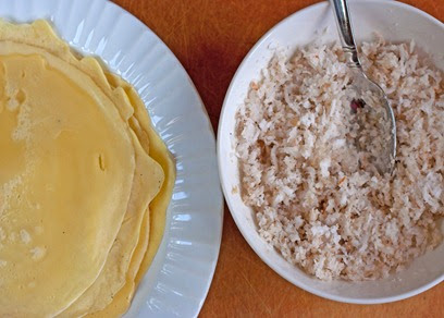 Crepes and cardamom flavored coconut