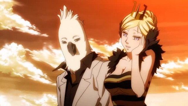 A man in a white suit with a cockatoo mask looks admiringly over at the blushing lady next to him in a queen bee outfit