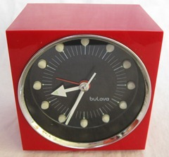 red Bulova alarm clock marked Japan No. 5058
