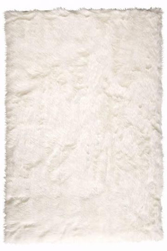 Faux Sheepskin Area Rug, $279, homedecorators.com.