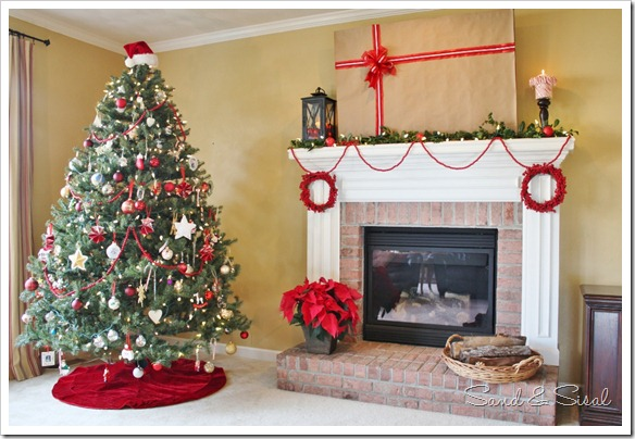 Decorating a christmas mantel around your tv sand and sisal for How to decorate a fireplace for christmas